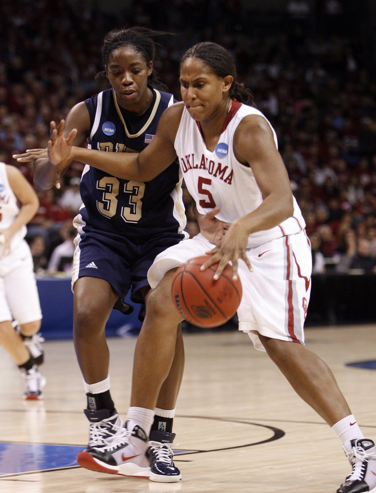 Photo - Ashley Paris dribbles past Xenia Stewart in the second half of the NCAA women's basketball tournament game between the University of Oklahoma and Pittsburgh at the Ford Center in Oklahoma City, Okla. on Sunday, March 29, 2009. 