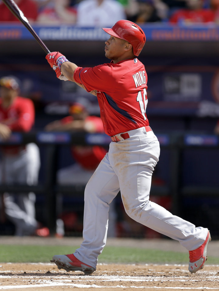 Photo - St. Louis Cardinals' Kolten Wong watches his ground-rule double to score Oscar Taveras during the second inning of an exhibition spring training baseball game against the New York Mets Friday, March 7, 2014, in Port St. Lucie, Fla. (AP Photo/Jeff Roberson)