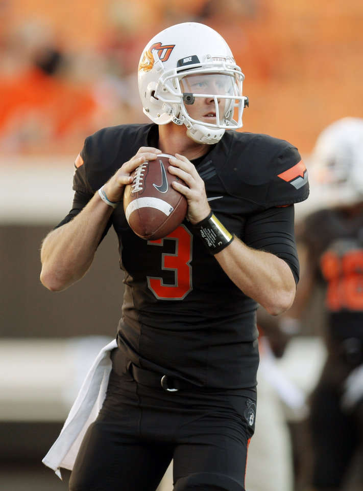 Oklahoma State's Brandon Weeden (3) warms up before the OSU-Arizona game Thursday night. PHOTO BY NATE BILLINGS, The Oklahoman