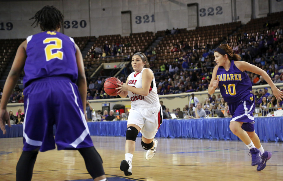 Photo - Ft. Gibson junior Allie Glover drives between Anadarko defenders Tandra King, left, and Kassidy Williams during the Class 4A State championship game between Ft. Gibson and Anadarko at Jim Norick Arena at State Fair Park  on Saturday, Mar. 15, 2014. Ft. Gibson came from behind much of the second half to win 50-47.  Photo by Jim Beckel, The Oklahoman