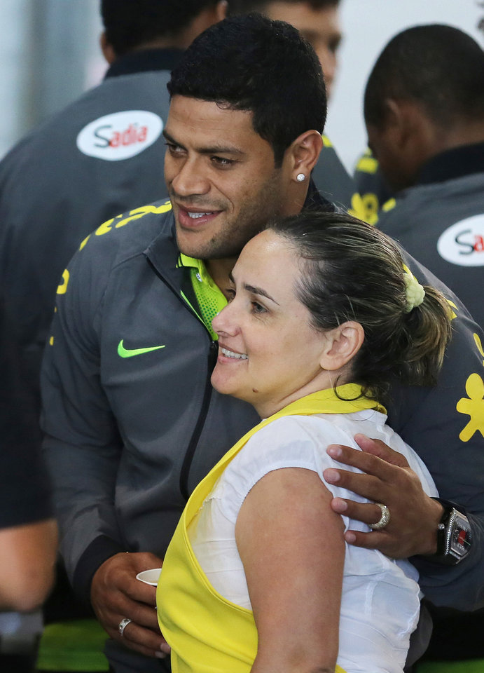Photo - Brazil's soccer player Hulk poses for a photo with a waitress who works at the Granja Comary training center where the team is preparing for the World Cup in Teresopolis, Brazil, Monday, May 26, 2014. The Brazil national team's preparations for its home World Cup got underway on Monday as the players selected by coach Luiz Felipe Scolari reported to the national team. (AP Photo/Leo Correa)