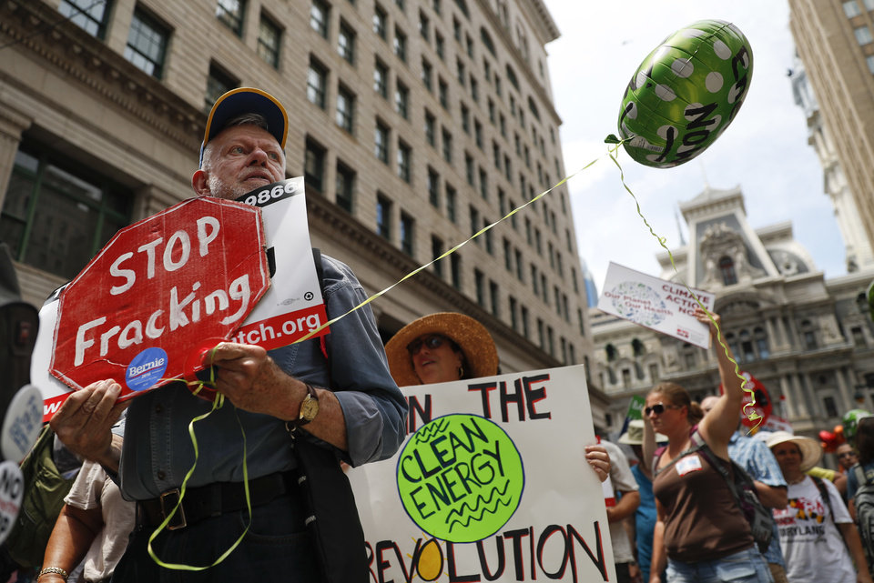 Photo - Environmental protesters march around downtown on Sunday, July 24, 2016, in Philadelphia. The Democratic National Convention starts Monday in Philadelphia. (AP Photo/John Minchillo)