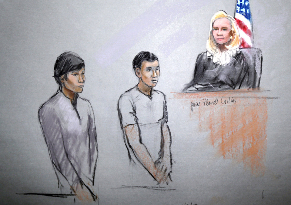 Photo - This courtroom sketch signed by artist Jane Flavell Collins shows defendants Dias Kadyrbayev, left, and Azamat Tazhayakov appearing in front of Federal Magistrate Marianne Bowler at the Moakley Federal Courthouse in Boston, Mass., Wednesday, May 1, 2013.  The two college friends of Boston Marathon bombing suspect Dzhokhar Tsarnaev, and another man, were arrested and charged with removing a backpack containing hollowed-out fireworks from Tsarnaev's dorm room. (AP Photo/Jane Flavell Collins)