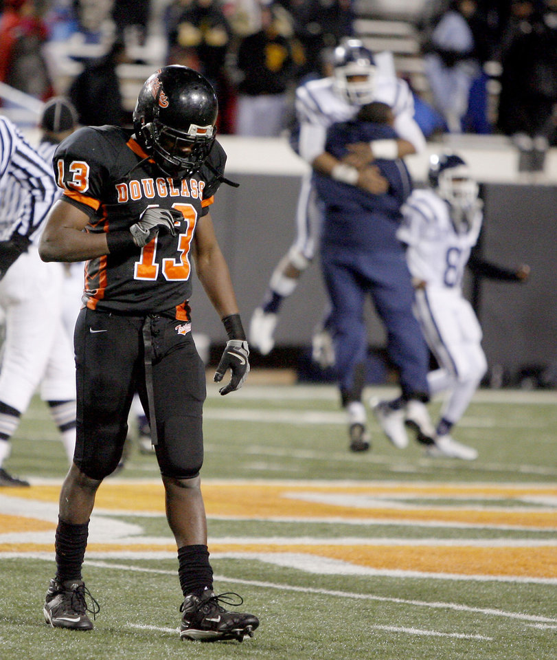 Photo - Clifford Hodges of Douglass walks off the field after losing the Class 4A high school football state championship game betweeen Star Spencer Douglass at Boone Pickens Stadium in Stillwater, Okla., Saturday, December 5, 2009. Photo by Bryan Terry, The Oklahoman
