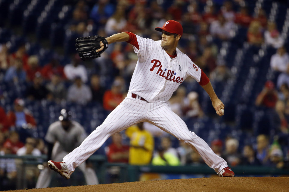 Photo - Philadelphia Phillies' Cole Hamels pitches during the first inning of a baseball game against the Colorado Rockies, Tuesday, May 27, 2014, in Philadelphia. (AP Photo/Matt Slocum)