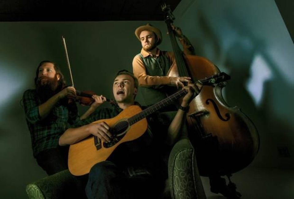Photo -  Oklahoma musicians Parker Millsap, center, plays with fiddler Daniel Foulks, left, and bassist Michael Rose at the OPUBCO studio in Oklahoma City, Okla. on Tuesday, Jan. 28, 2014. Photo by Chris Landsberger, The Oklahoman