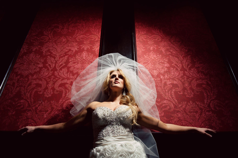 Photo - Malorie Gulikers poses during her bridal photo shoot. Photo by Traina Photography.