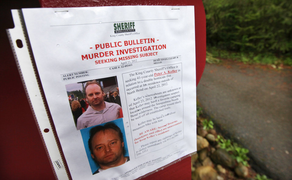 Photo -   A sign warning of murder suspect Peter Alex Keller is seen at a trailhead several miles from where a gun-toting survivalist is suspected of killing his wife and daughter several days earlier Friday, April 27, 2012, in North Bend, Wash. Keller may be holed up in a self-made fort not far from where Seattle's outer suburbs give way to the vast recreational playground of Cascade Mountains. Police expect more people to hit the nearby trails this weekend, and deputies are warning them to steer clear of Keller if they think they see him. (AP Photo/Elaine Thompson)