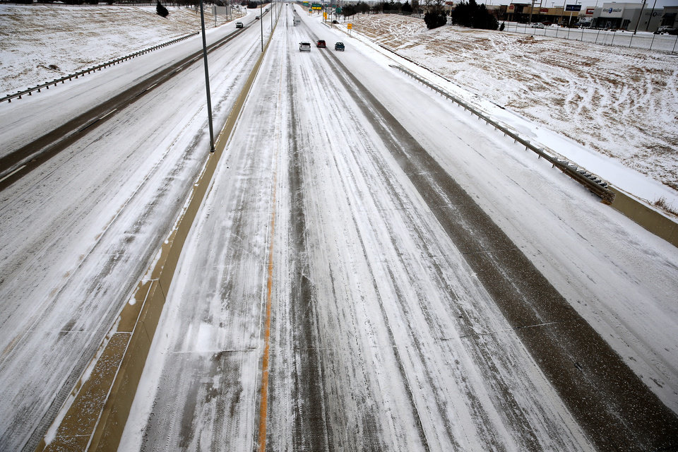 Photo - Cars travel east on the Kilpatrick Turnpike in Oklahoma City, Sunday, Feb. 14, 2021. Photo by Sarah Phipps, The Oklahoman