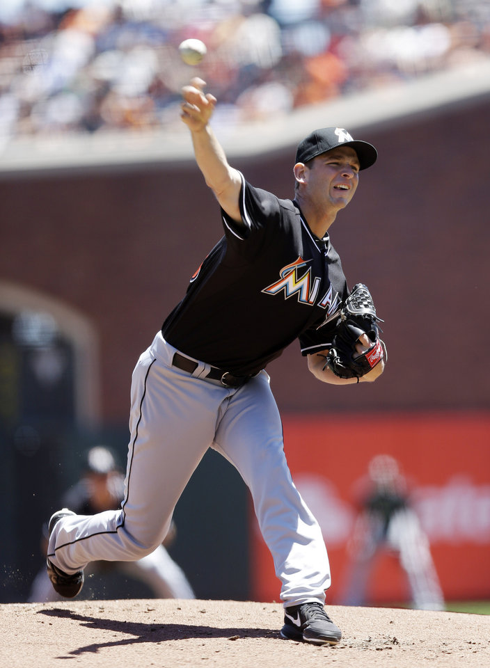 Photo - Miami Marlins starting pitcher Jacob Turner throws to the San Francisco Giants during the first inning of a baseball game on Saturday, June 22, 2013, in San Francisco. (AP Photo/Marcio Jose Sanchez)