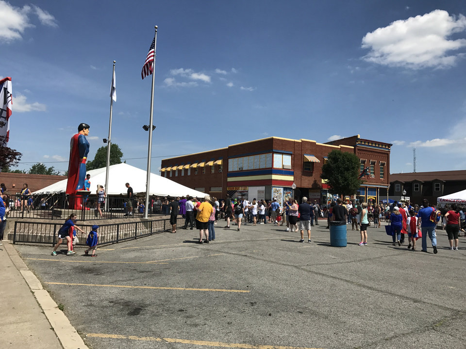 Photo -  Fans gather in Superman Square as the Super Museum is seen in the background at the Superman Celebration. [photo by Matthew Price, The Oklahoman]