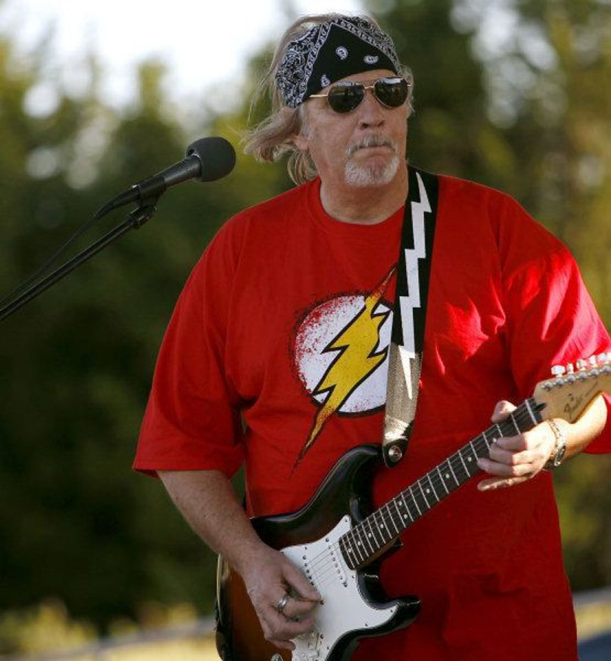 Photo - Bud Kurtz, with the band Straight Shooter, performs at the Mitch Park Amphitheater. PHOTO BY JOHN CLANTON, THE OKLAHOMAN.  JOHN CLANTON - THE OKLAHOMAN