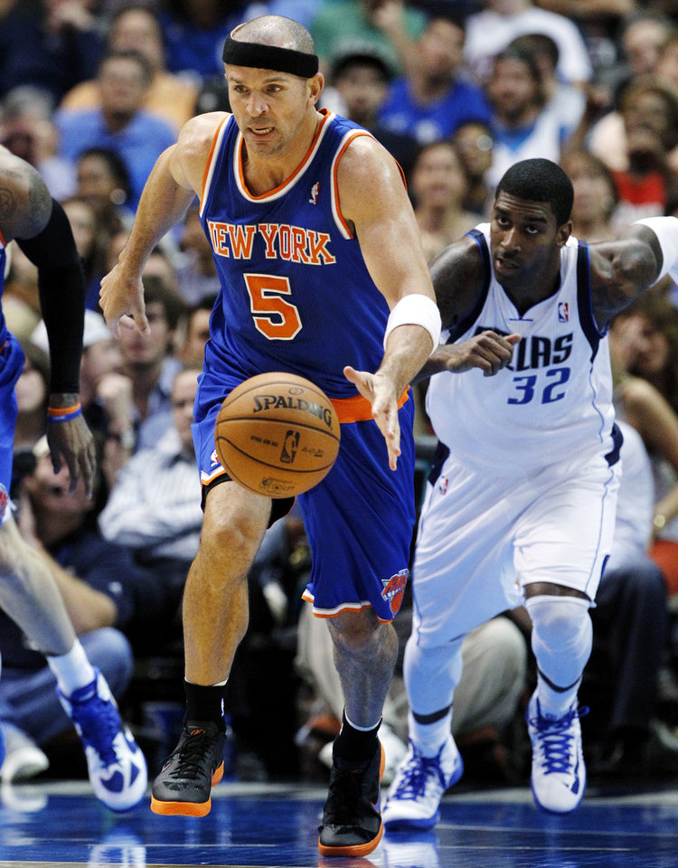 Photo -   New York Knicks' Jason Kidd (5) comes away with a steal against Dallas Mavericks' Chris Kaman, not pictured, as O.J. Mayo (32) gives chase in the first half of an NBA basketball game, Wednesday, Nov. 21, 2012, in Dallas. (AP Photo/Tony Gutierrez)