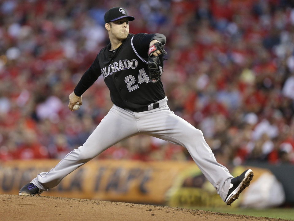 Photo - Colorado Rockies starting pitcher Jordan Lyles throws against the Cincinnati Reds in the fourth inning of a baseball game on Saturday, May 10, 2014, in Cincinnati. (AP Photo/Al Behrman)