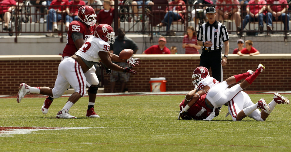 Photo - Jordan Wade intercepts a pass intended for K. J. Young during the Spring College Football Game of the University of Oklahoma Sooners (OU) at Gaylord Family-Oklahoma Memorial Stadium in Norman, Okla., on Saturday, April 12, 2014.  Photo by Steve Sisney, The Oklahoman