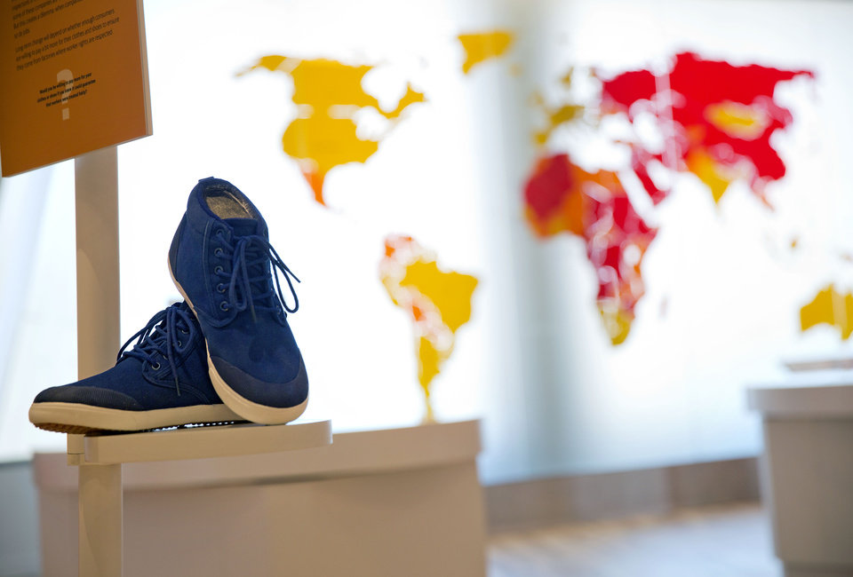 Photo - In this June 16, 2014 photo, a pair of sneakers are displayed as part of an exhibit exploring the ethical footprint of common consumer products at the newly built National Center for Civil and Human Rights in Atlanta. The new museum about the history of civil rights opens next week in Atlanta, the city where Martin Luther King Jr. was based. But the National Center for Civil and Human Rights also explores other human rights struggles, from women's rights and LGBT issues to immigration and child labor. The museum devotes separate galleries to modern human rights issues and the U.S. civil rights movement of the 1950s and '60s, but also demonstrates how the two struggles are related. Visitors learn history through interactive exhibits and stories of real people. (AP Photo/David Goldman)