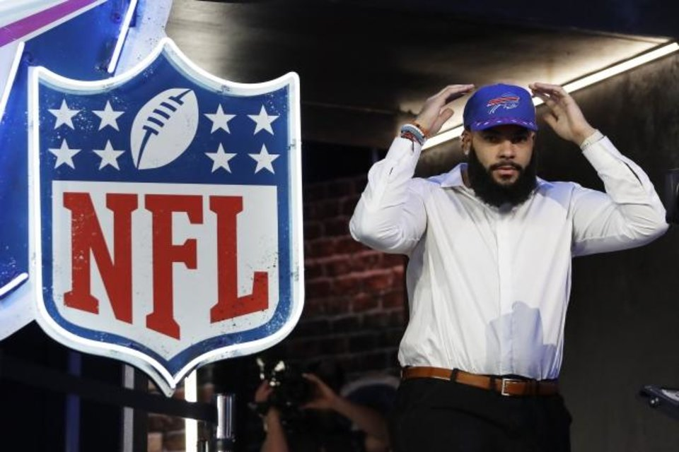 Photo -  Former Oklahoma guard Cody Ford enters the stage after the Buffalo Bills selected him during the second round of the NFL Draft on Friday in Nashville. [AP Photo/Mark Humphrey]