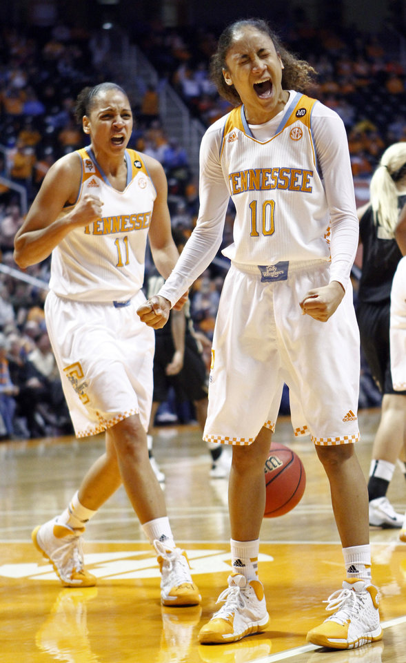 Photo - Tennessee guard Meighan Simmons (10) and Cierra Burdick (11) react to a play in the second half of an NCAA college basketball game against Vanderbilt, Monday, Feb. 10, 2014, in Knoxville, Tenn. Tennessee won 81-53. (AP Photo/Wade Payne)