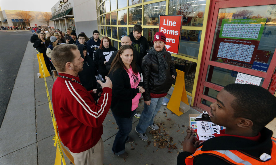 Photo - Shoppers get an early start on Black Friday as they wait in line at Toys