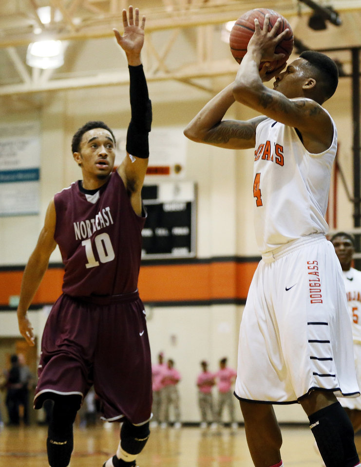 De\'Angelo Smith (4) of Douglass shoots against Shawndale Pina (10) of Northeast during a boys high school basketball game between Douglass and Northeast at Douglass High School in Oklahoma City, Friday, Feb. 8, 2013. Photo by Nate Billings, The Oklahoman