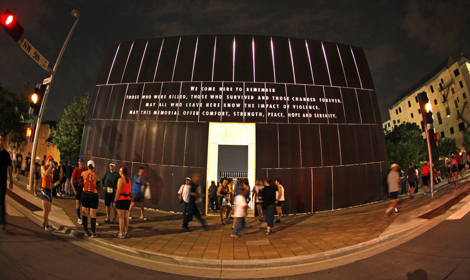 People walk past the Oklahoma City National Memorial & Museum before the Oklahoma City Memorial Marathon in Oklahoma City, Sunday, April 29, 2012. Photo by Bryan Terry, The Oklahoman