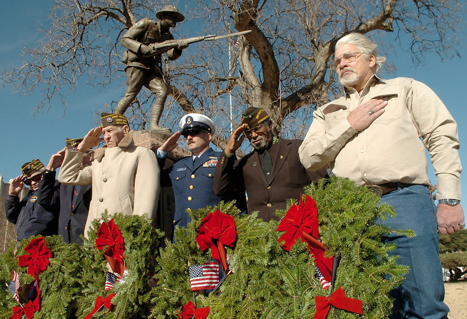 Photo - From left, veterans George Sands, Gerry Wheeler, Ed Steffey, Dave Schacher, Lloyd Pitts and Alfred Thomas salute during
