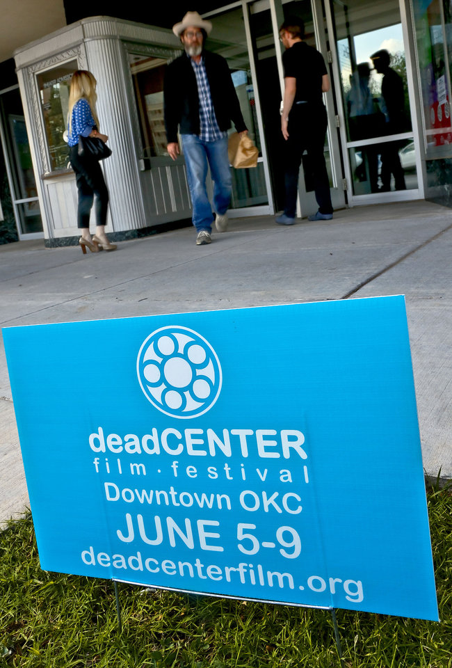 """Photo -  Film enthusiasts walk to the theater Wednesday to attend the opening night of the deadCenter Film Festival with the showing of """"The Rolling Stones: Charlie is My Darling"""" at Oklahoma City Museum of Art  in Oklahoma City. Photo by Chris Landsberger, The Oklahoman   CHRIS LANDSBERGER -"""