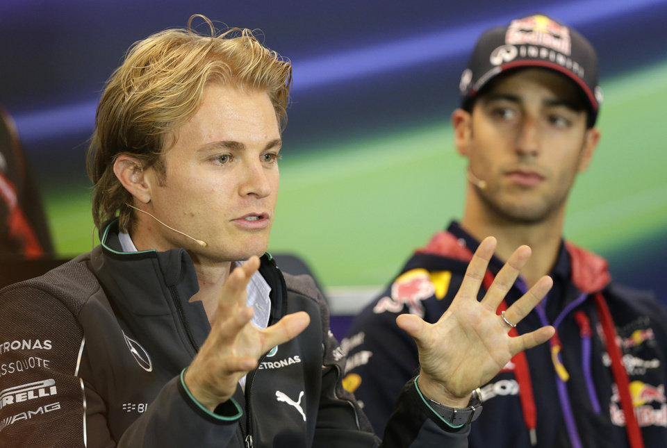 Photo - Red Bull driver Daniel Ricciardo of Australia, right, looks at Mercedes driver Nico Rosberg of Germany, as he addresses the media ahead of Sunday's Belgian Formula One Grand Prix in Spa-Francorchamps, Belgium, Thursday, Aug. 21, 2014. (AP Photo/Yves Logghe)