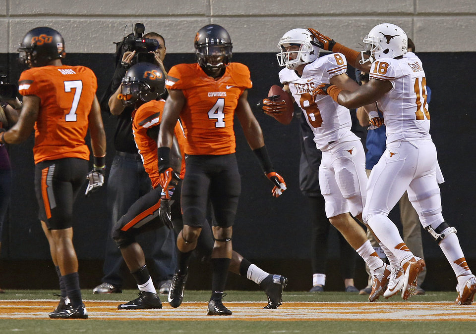 Texas' Jaxon Shipley (8) and D.J. Grant (18) celebrate beside Oklahoma State's Shamiel Gary (7) and Justin Gilbert (4) after touchdown during a college football game between Oklahoma State University (OSU) and the University of Texas (UT) at Boone Pickens Stadium in Stillwater, Okla., Saturday, Sept. 29, 2012. Oklahoma State lost 41-36. Photo by Bryan Terry, The Oklahoman