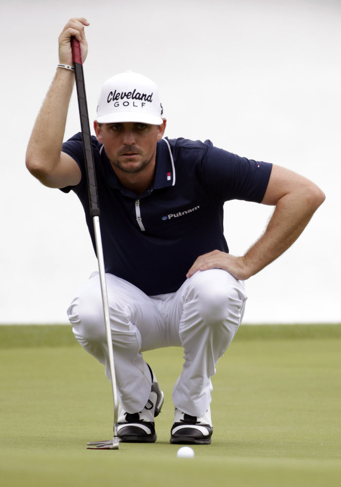 Photo - Keegan Bradley measures his shot on the fourth green during the first round of the Houston Open golf tournament on Thursday, April 3, 2014, in Humble Texas. (AP Photo/Patric Schneider)