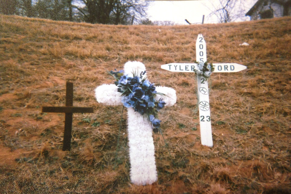 Photo - Crosses mark the site along Interstate 40 where Billy Long crashed his car. His passenger and best friend, Tyler Ford, died at the scene. Photo provided