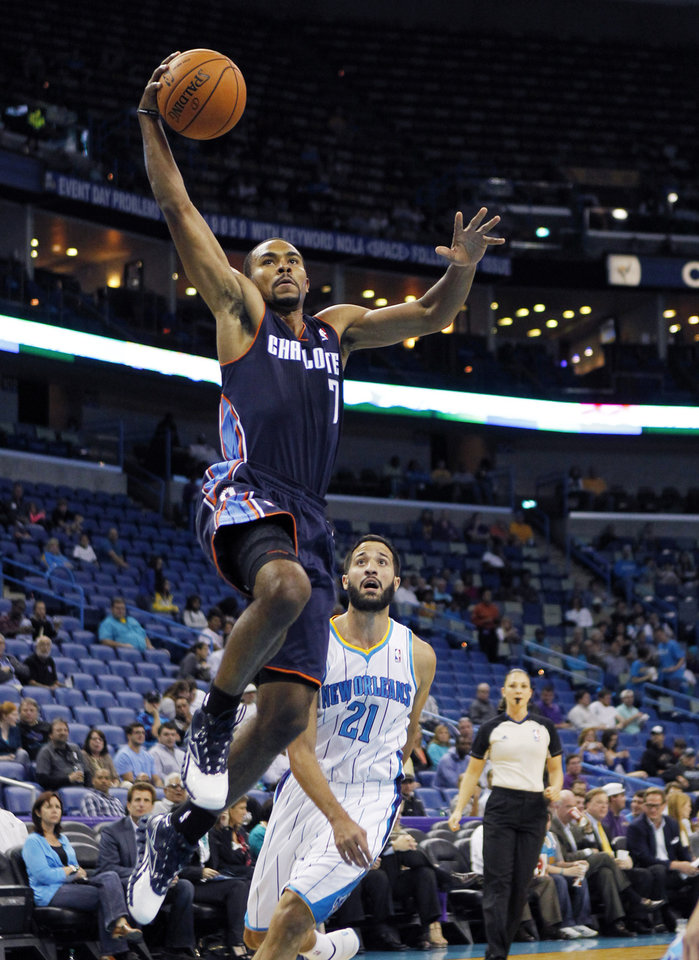 Charlotte Bobcats guard Ramon Sessions (7) drives to the basket in front of New Orleans Hornets guard Greivis Vasquez (21) during the first half of an NBA preseason basketball game in New Orleans, Tuesday, Oct. 9, 2012. (AP Photo/Gerald Herbert)