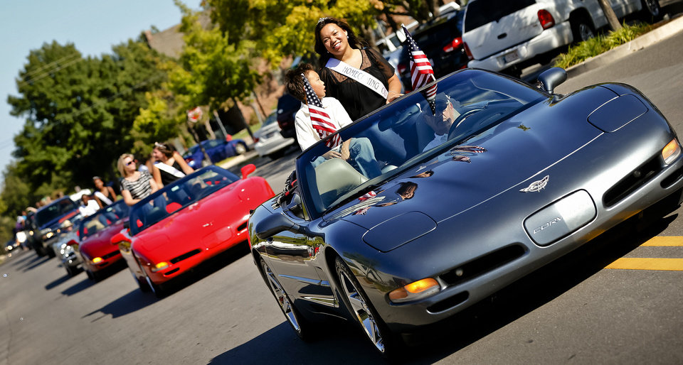 The homecoming court ride in convertible Corvettes during the Edmond Santa Fe High School homecoming parade.  Photo by Chris Landsberger, The Oklahoman <strong>CHRIS LANDSBERGER</strong>