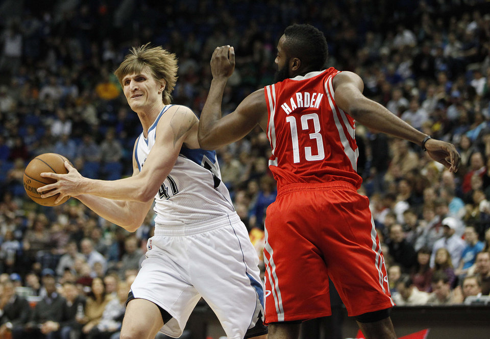 Photo - Minnesota Timberwolves forward Andrei Kirilenko, left, passes around Houston Rockets guard James Harden (13) in the first half of an NBA basketball game on Saturday, Jan. 19, 2013, in Minneapolis. (AP Photo/Stacy Bengs)