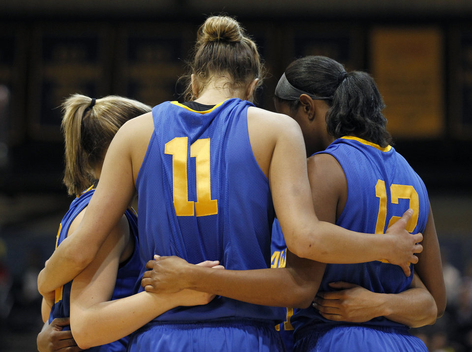 Photo - Delaware guard/forward Elena Delle Donne (11) huddles with her teammates during the first half of an NCAA college basketball game with Drexel Sunday, Feb. 19, 2012 in Philadelphia. Delaware won 40-39. (AP Photo/Alex Brandon)  Alex Brandon