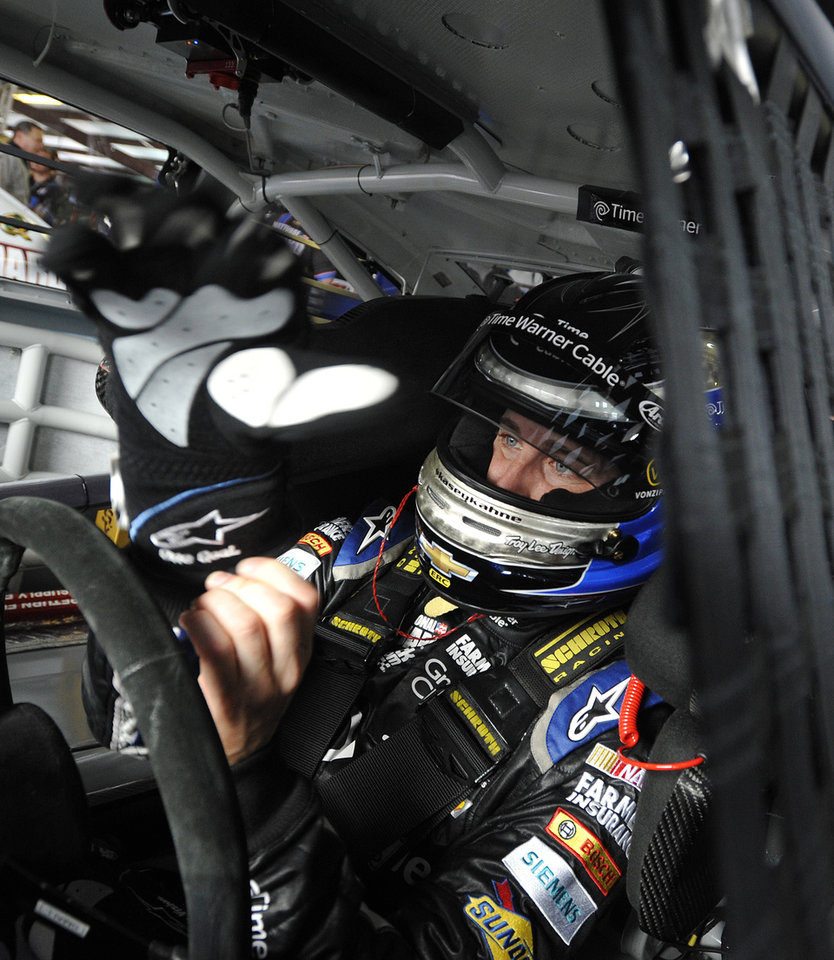 Photo - Driver Denny Hamlin sits in his car as he prepares for practice Sunday's NASCAR Sprint Cup series auto race at the Talladega Superspeedway in Talladega, Ala., Friday, May 3, 2013. Hamlin has been cleared by NASCAR to drive this week at Talladega following an injury he suffered at California. (AP Photo/Rainier Ehrhardt)