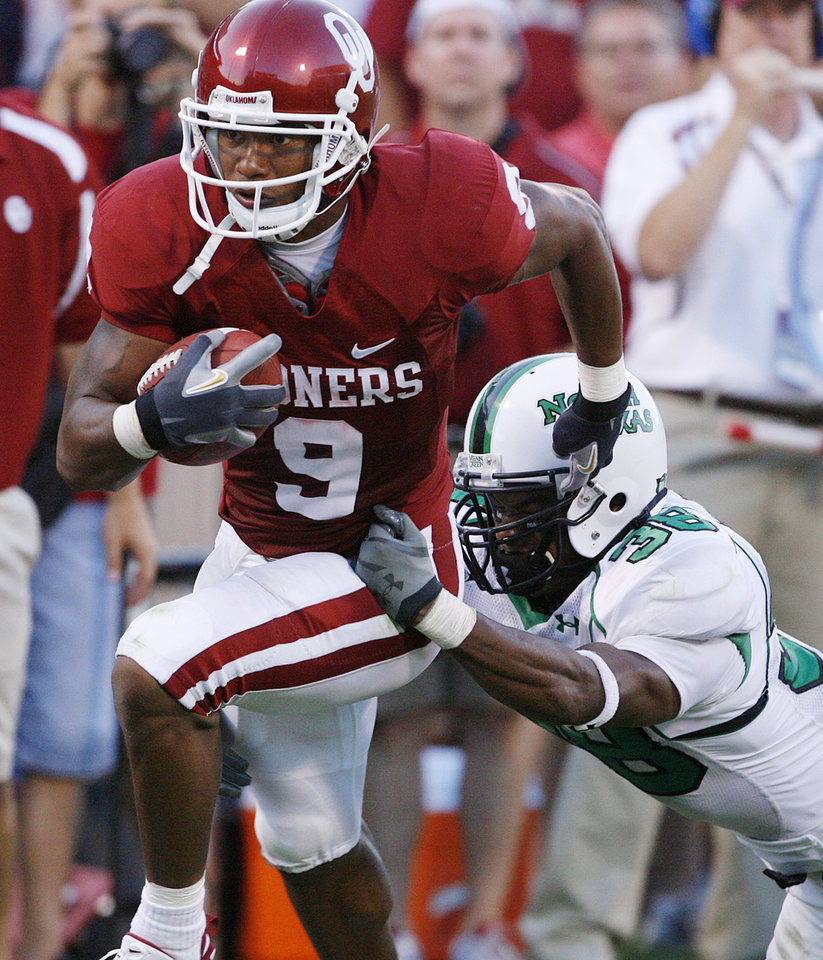 Photo - Oklahoma's Juaquin Iglesias (9) takes the ball past North Texas' Aaron Weathers (38) in the first half during the University of Oklahoma Sooners (OU) college football game against the University of North Texas Mean Green (UNT) at the Gaylord Family -- Oklahoma Memorial Stadium, on Saturday, Sept. 1, 2007, in Norman, Okla.   By STEVE SISNEY, The Oklahoman  ORG XMIT: KOD
