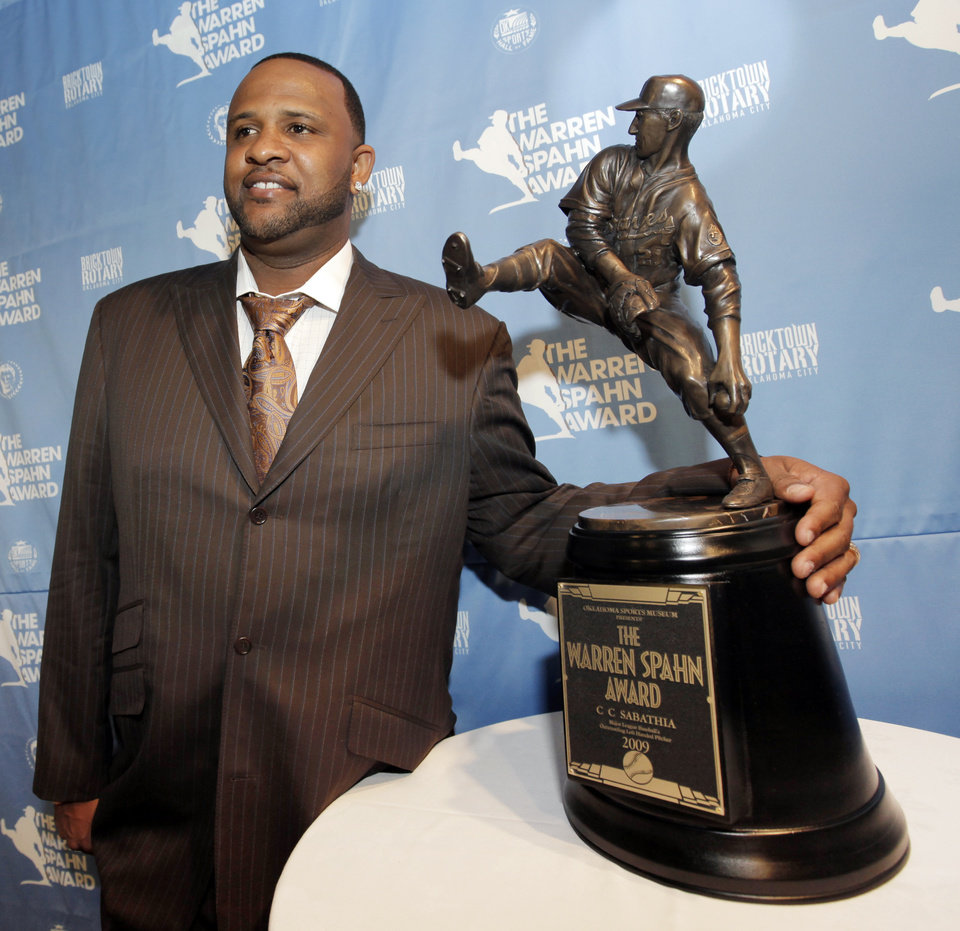 Photo - CC SABATHIA: New York Yankees pitcher C.C. Sabathia poses for a photo with the Warren Spahn Award trophy during a press conference before the Warren Spahn Award Gala at the Oklahoma Sports Hall of Fame & Jim Thorpe Museum in Oklahoma City, Tuesday, January 26, 2010. This is the third consecutive year Sabathia has won the award, which honors the best left-handed pitcher in major league baseball. Photo by Nate Billings, The Oklahoman ORG XMIT: KOD