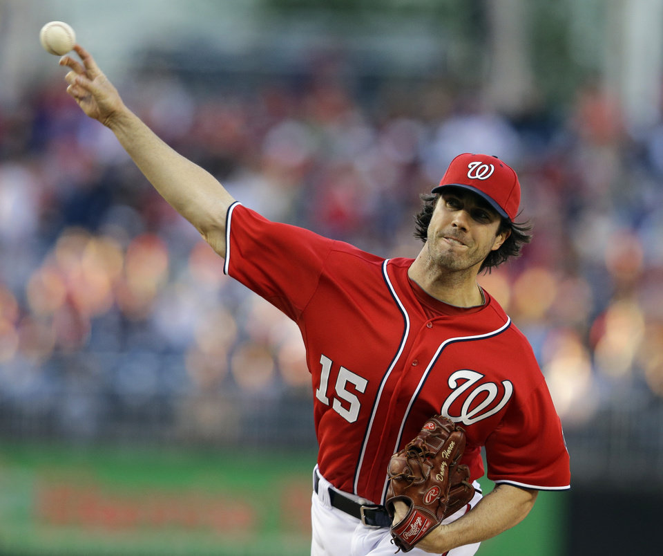 Photo - Washington Nationals starting pitcher Dan Haren (15) throws during the first inning of a baseball game against the Philadelphia Phillies at Nationals Park, Saturday, May 25, 2013, in Washington. (AP Photo/Alex Brandon)