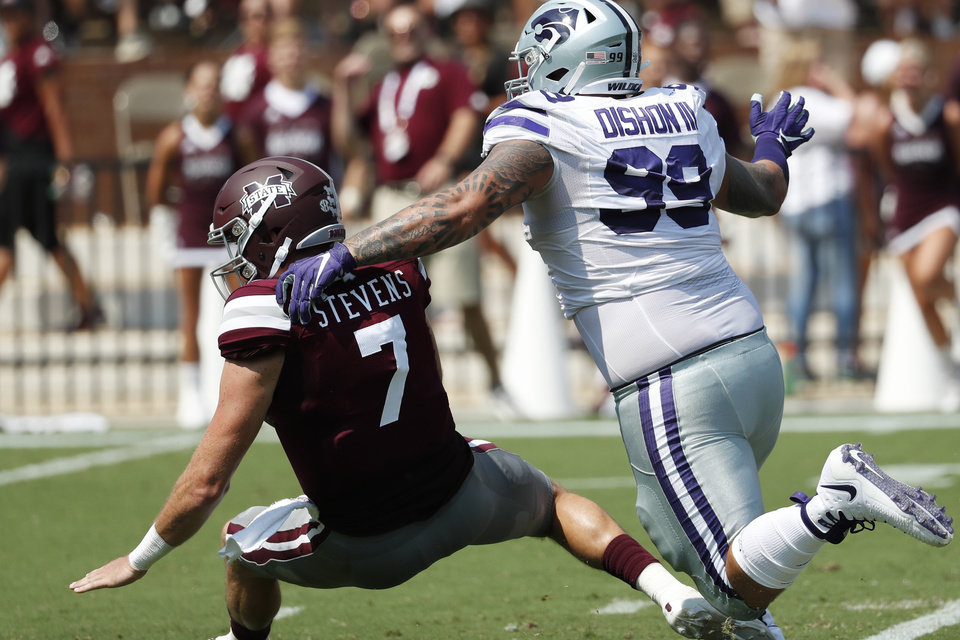 Photo - Mississippi State quarterback Tommy Stevens (7) is sacked by Kansas State Trey Dishon (99) during the first half of their NCAA college football game in Starkville, Miss., Saturday, Sept. 14, 2019. (AP Photo/Rogelio V. Solis)