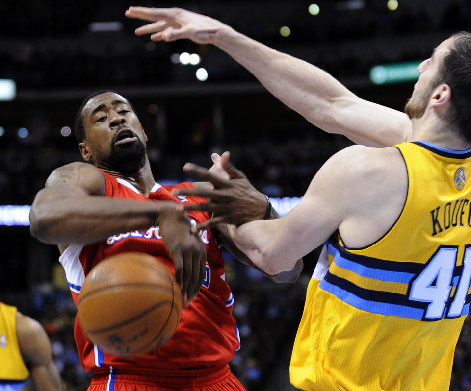 Photo - Los Angeles Clippers center DeAndre Jordan (6) loses the ball against Denver Nuggets center Kosta Koufos (41) during the first quarter of an NBA basketball game, Tuesday, Jan. 1, 2013, in Denver. (AP Photo/Jack Dempsey)