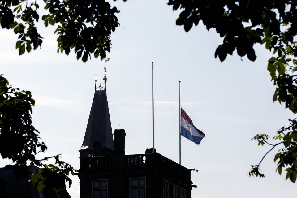 Photo - A flag flies half-staff at Binnenhof, the seat of the Dutch government, in The Hague, Netherlands, Friday, July 18, 2014. Flags are flying half-staff across the Netherlands as the country mourns at least 154 of its citizens killed when a Malaysia Airlines passenger jet was shot down in eastern Ukraine. (AP Photo/Phil Nijhuis)