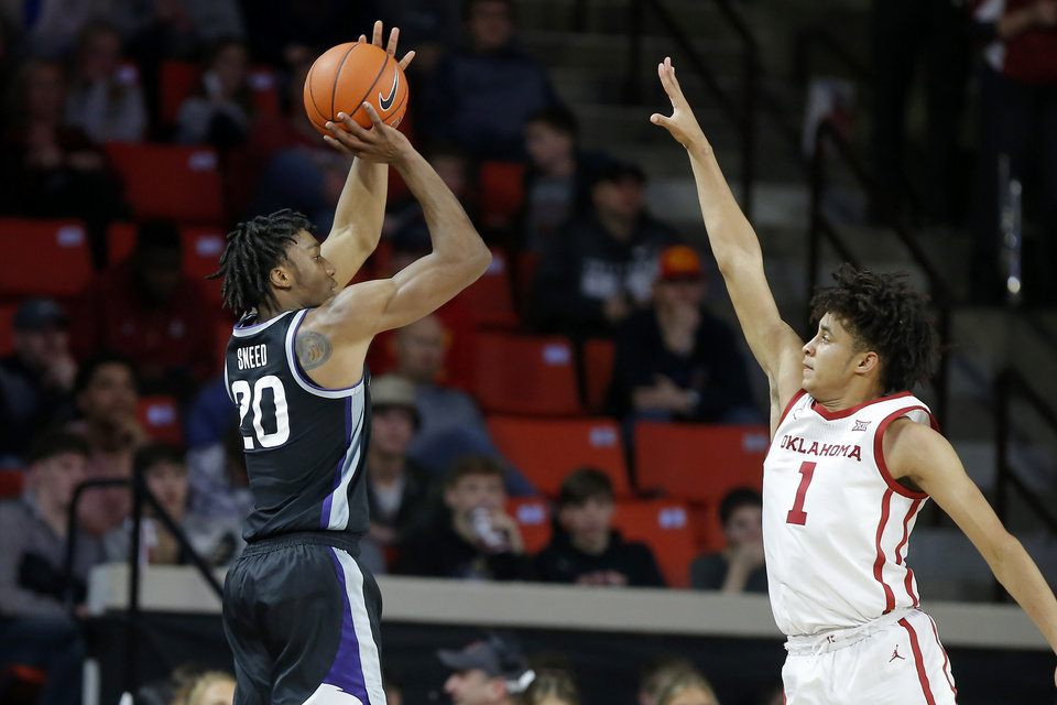Photo - Kansas State's Xavier Sneed (20) shoots a basket over Oklahoma's Jalen Hill (1) during an NCAA college basketball game between the University of Oklahoma Sooners (OU) and the Kansas State Wildcats at Lloyd Noble Center in Norman, Okla., Saturday, Jan. 4, 2020. Oklahoma won 66-61. [Bryan Terry/The Oklahoman]