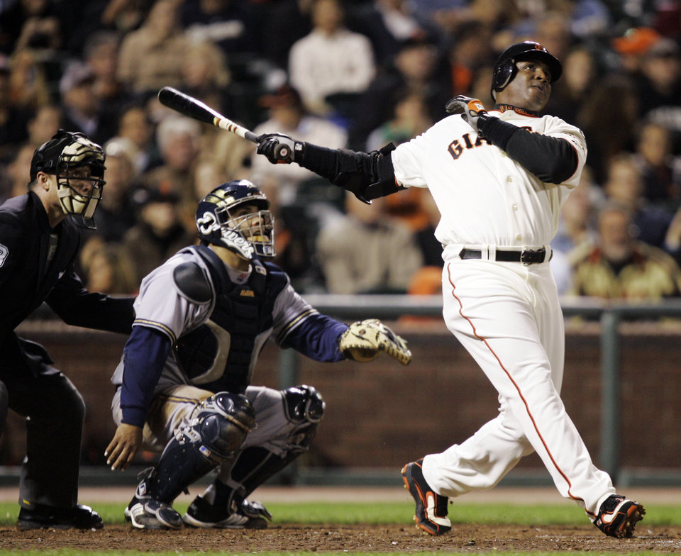 FILE - In this Aug. 24, 2007, file photo, San Francisco Giants\' Barry Bonds, right, hits his 761st career home run, a solo effort, off Milwaukee Brewers pitcher Chris Capuano in the fourth inning of a baseball game in San Francisco. Bonds, Roger Clemens and Sammy Sosa are set to show up on the Hall of Fame ballot for the first time on Wednesday, Nov. 28, 2012, and fans will soon find out whether drug allegations block the former stars from reaching baseball\'s shrine. (AP Photo/Marcio Jose Sanchez, File)