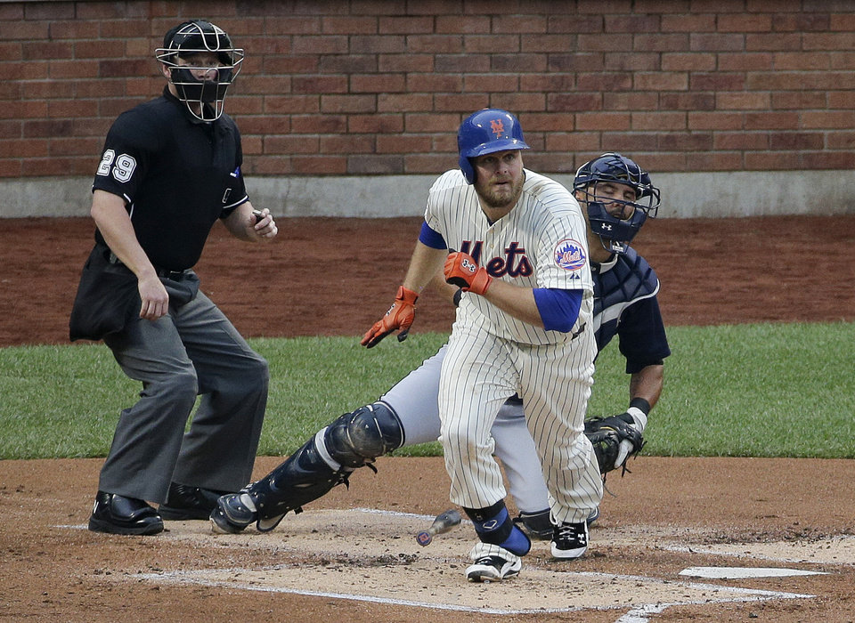 Photo - New York Mets first baseman Lucas Duda (21) breaks down the first base line on an RBI base hit to right field which allowed Daniel Murphy to score in the first inning of a baseball game against the Atlanta Braves, Wednesday, July 9, 2014, in New York. (AP Photo/Julie Jacobson)