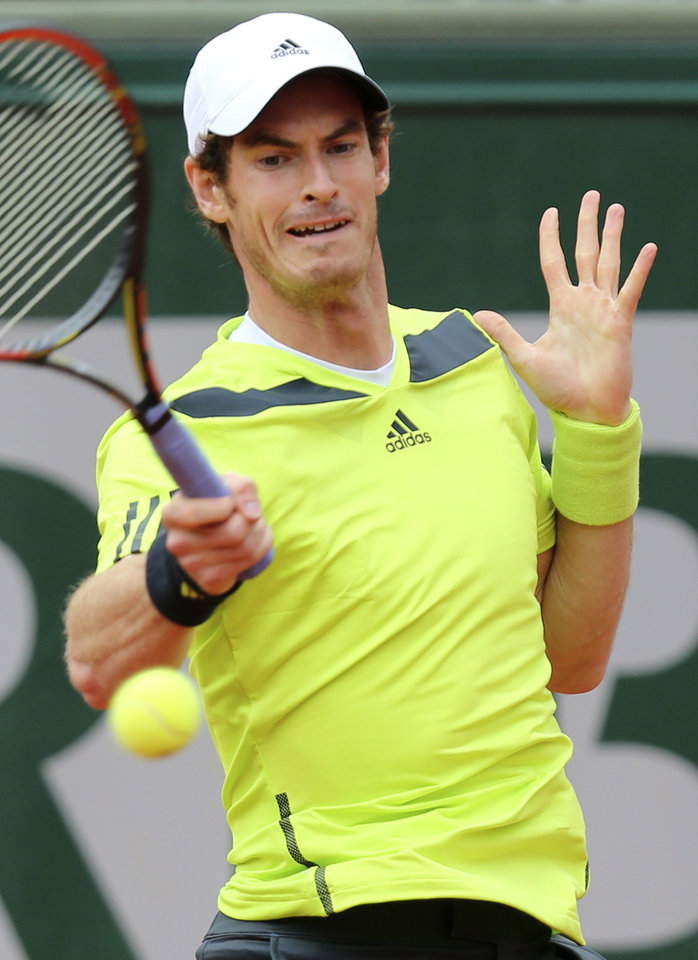 Photo - Britain's Andy Murray returns the ball to Kazakhstan's Andrey Golubev during the first round match of  the French Open tennis tournament at the Roland Garros stadium, in Paris, France, Tuesday, May 27, 2014. (AP Photo/David Vincent)