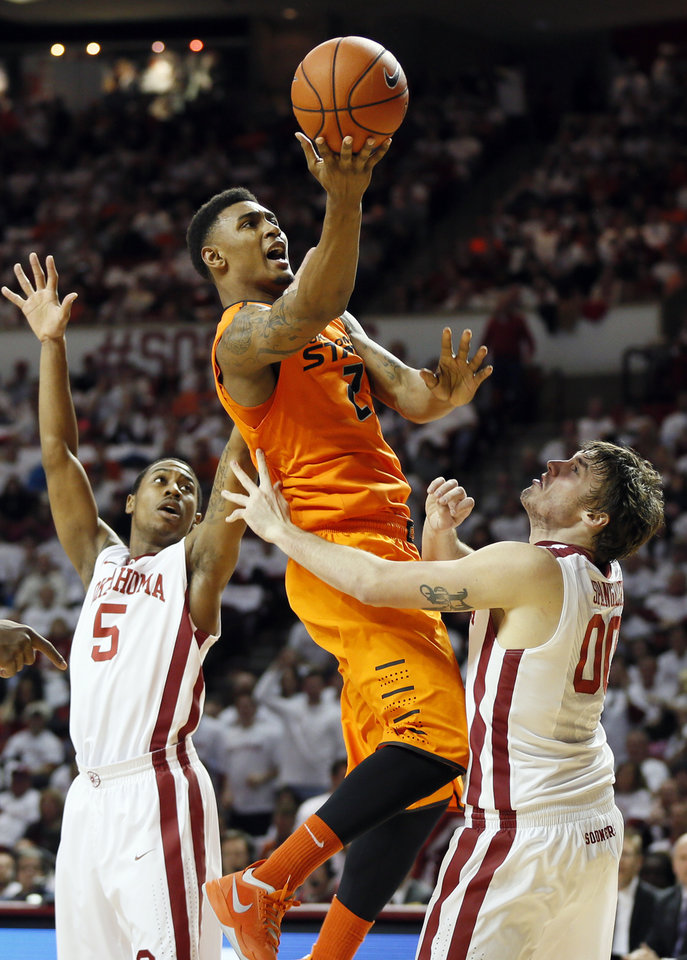 Oklahoma State's Le'Bryan Nash (2) tries to score between Oklahoma's Je'lon Hornbeak (5) and Ryan Spangler (00) in the first half during the NCAA men's Bedlam basketball game between the Oklahoma State Cowboys (OSU) and the Oklahoma Sooners (OU) at Lloyd Noble Center in Norman, Okla., Monday, Jan. 27, 2014. Photo by Nate Billings, The Oklahoman