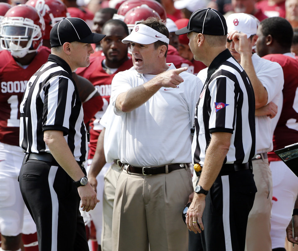 Photo - Head coach Bob Stoops protests an ejection call against Gabe Lynn during a college football game between the University of Oklahoma Sooners (OU) and the Tulsa Golden Hurricane (TU) at Gaylord Family-Oklahoma Memorial Stadium in Norman, Okla., on Saturday, Sept. 14, 2013. Photo by Steve Sisney, The Oklahoman