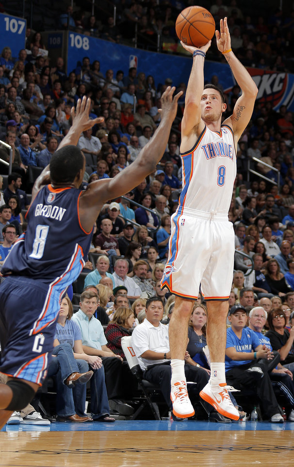 Photo - Oklahoma City's Andy Rautins (8) shoots over Charlotte's Ben Gordon (8) during the preseason NBA game between the Oklahoma City Thunder and the Charlotte Bobcats at Chesapeake Energy Arena in Oklahoma City, Tuesday, Oct. 16, 2012. Photo by Sarah Phipps, The Oklahoman
