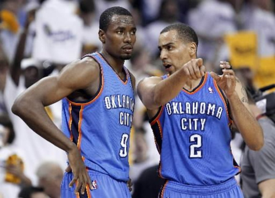 Thabo Sefolosha (right) became the second Thunder player to agree to a deal overseas. There\'s a good chance Serge Ibaka could be next.